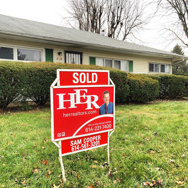 Sam Cooper HER Realtors Sold Sign